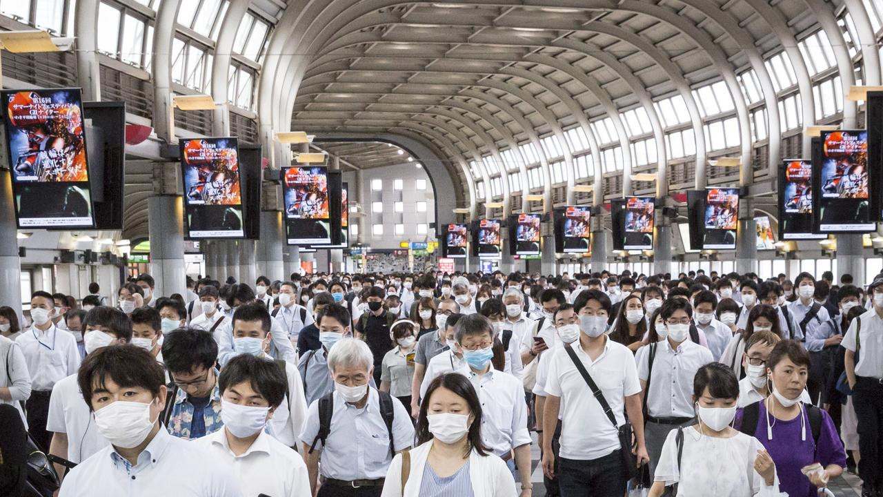 Japan bans foreign visitors as COVID-19 cases spike and new variant detected