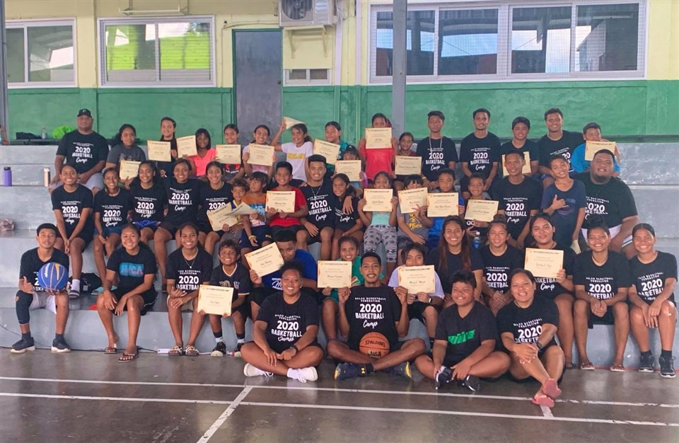 Some of the participants of the basketball camp with coaches ©PNOC