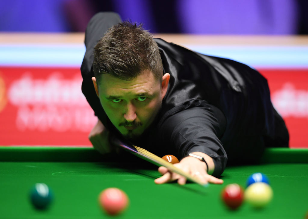 Wilson beats defending champion Trump to reach semi-finals of World Snooker Championship