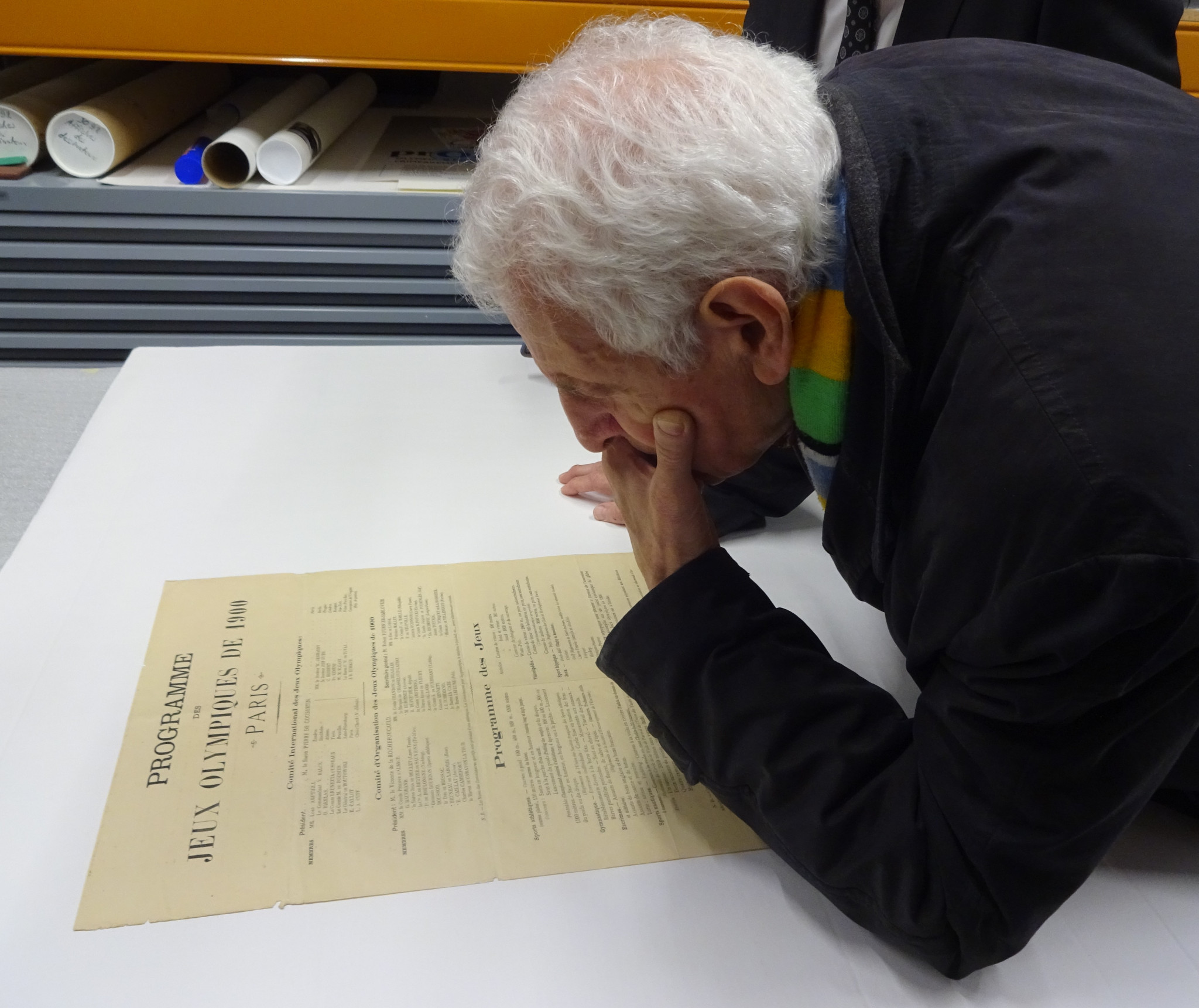 French historian Jean Durry studies the document showing that Pierre de Coubertin wanted the first modern Olympics in Paris in 1900 ©Philip Barker