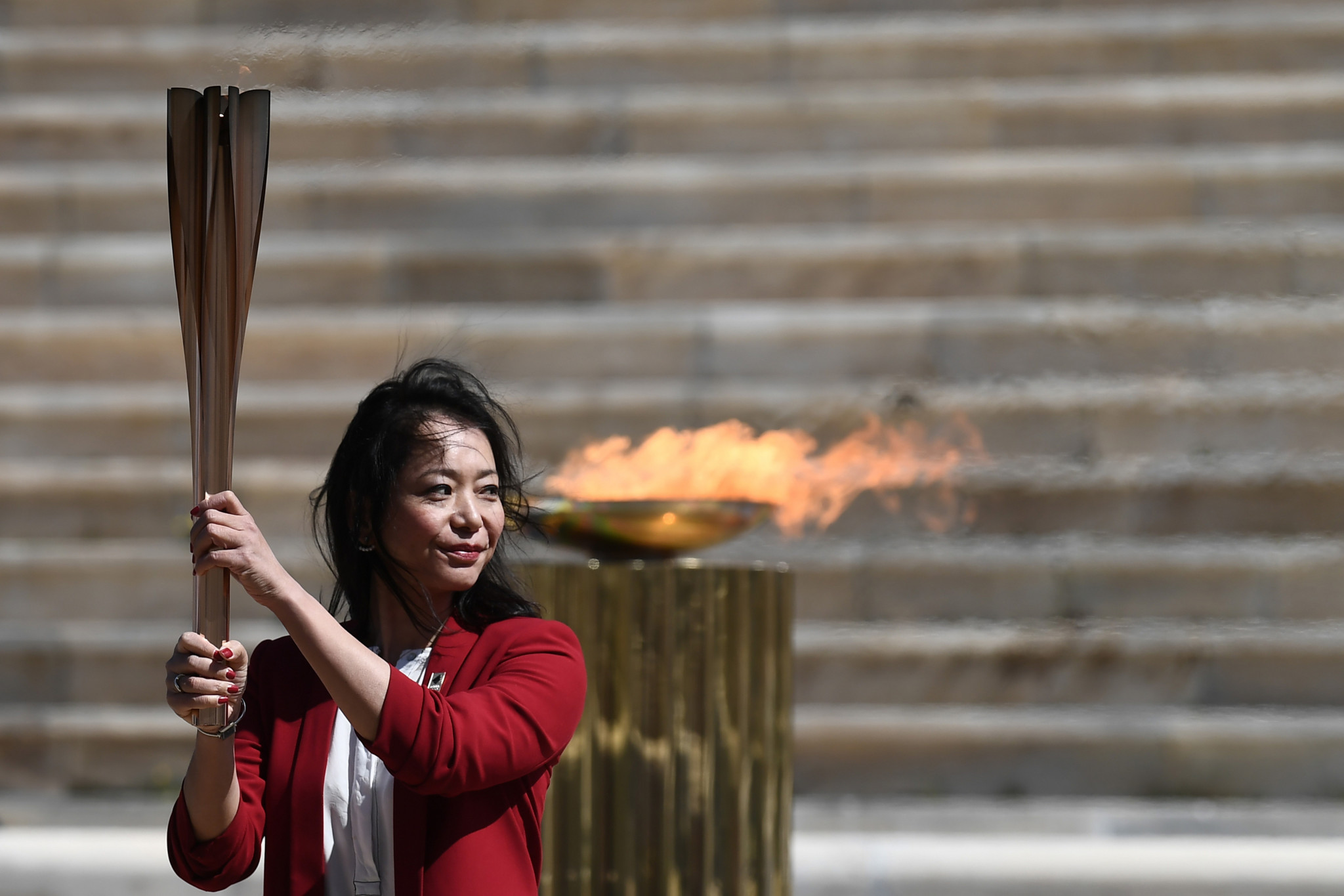 Naoko Imoto received the Olympic Flame on Tokyo 2020's behalf ©Getty Images