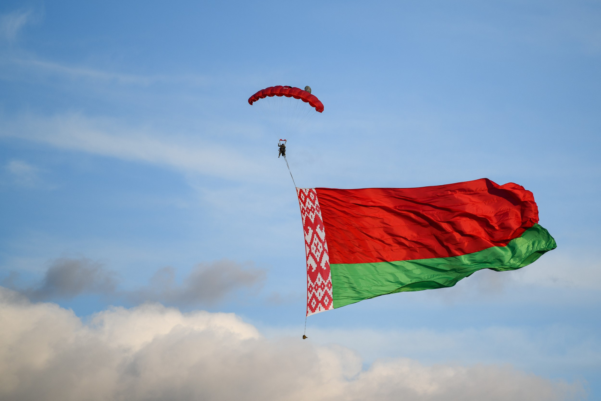 A skydiver displayed the Belarus flag as part of the