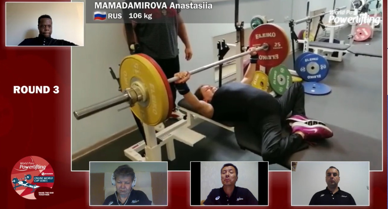 The judges watch on as Anastasiia Mamadamirova attempts to lift 106 =kg in the latest leg of the Online World Cup ©World Para Powerlifting