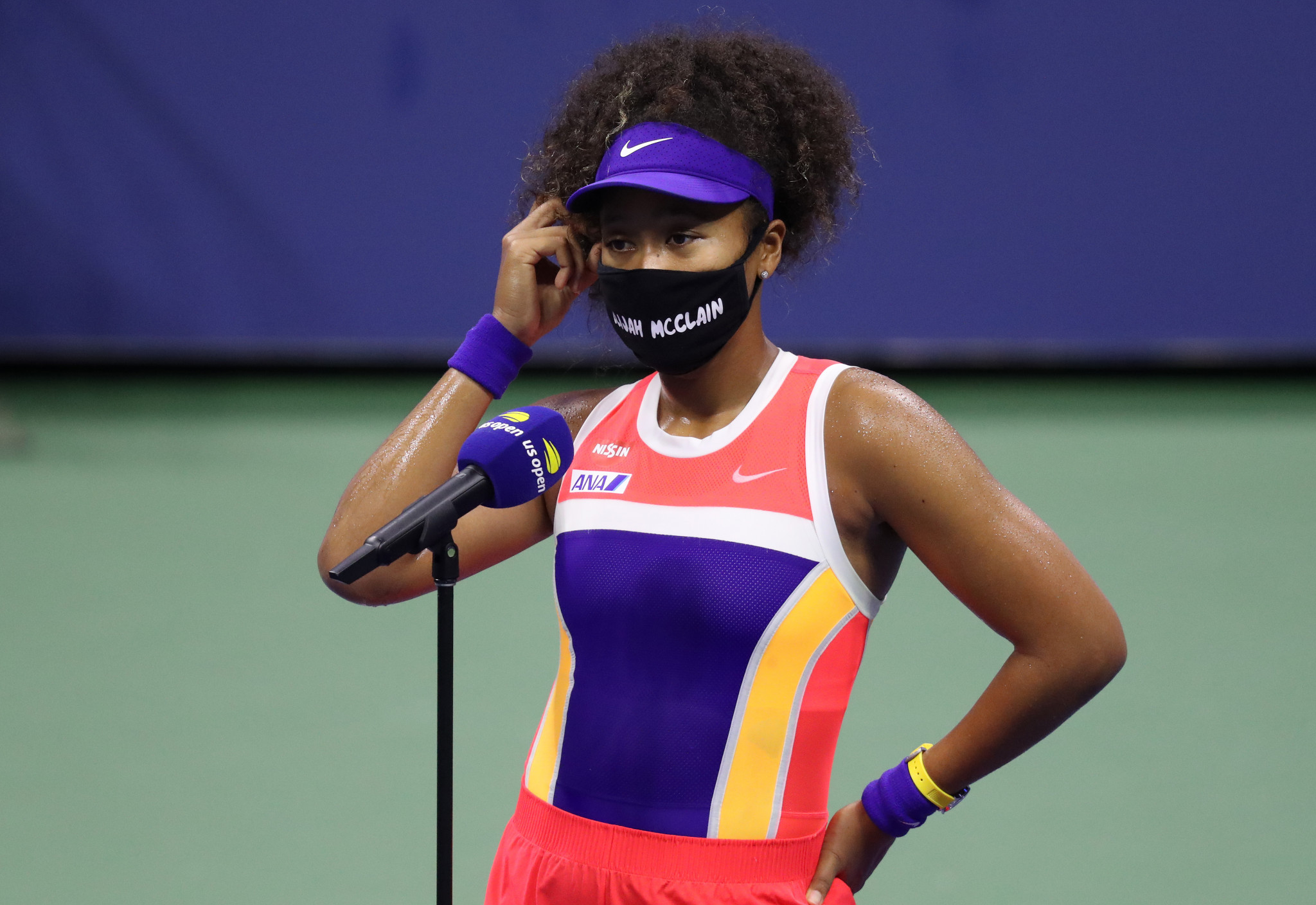 Japan's Naomi Osaka, wearing one of her collection of facemasks, is interviewed after her round two win ©Getty Images