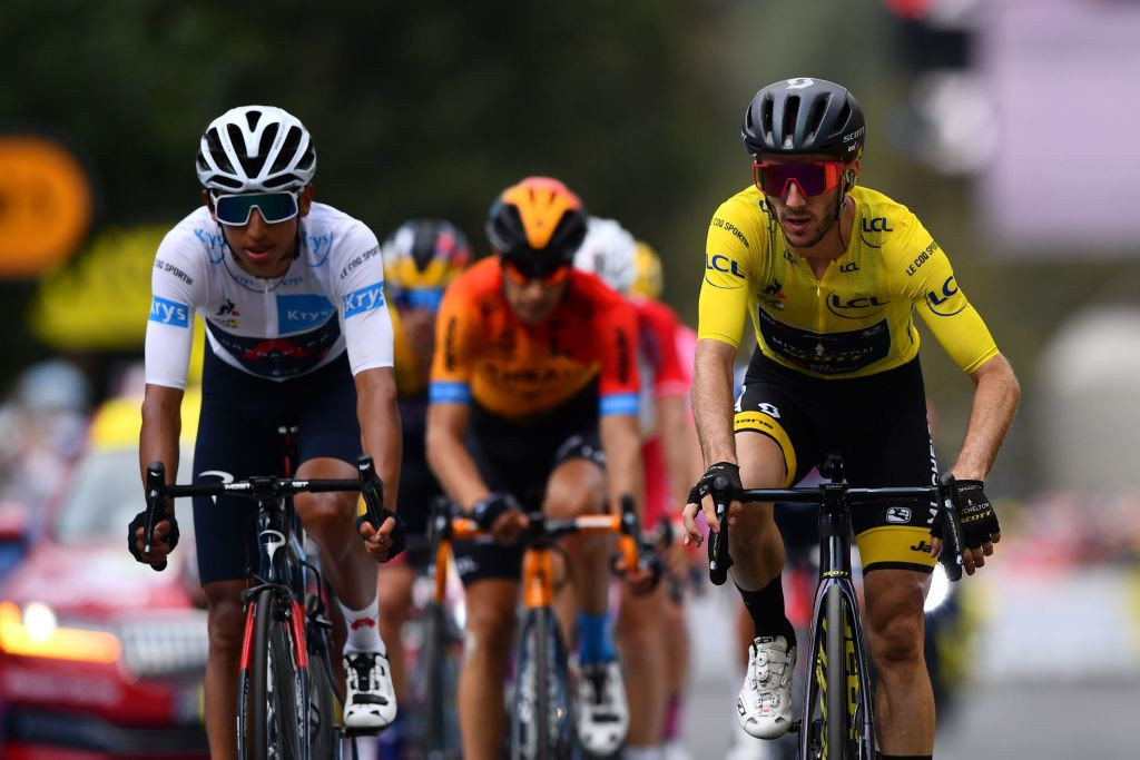 Yates fights off rivals to stay in yellow at Tour de France