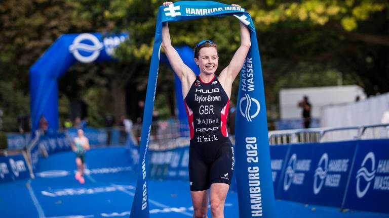 Britain's Georgina Taylor-Brown, who had never previously finished higher than third in a World Triathlon Series event, celebrates becoming world champion in Hamburg ©World Triathlon