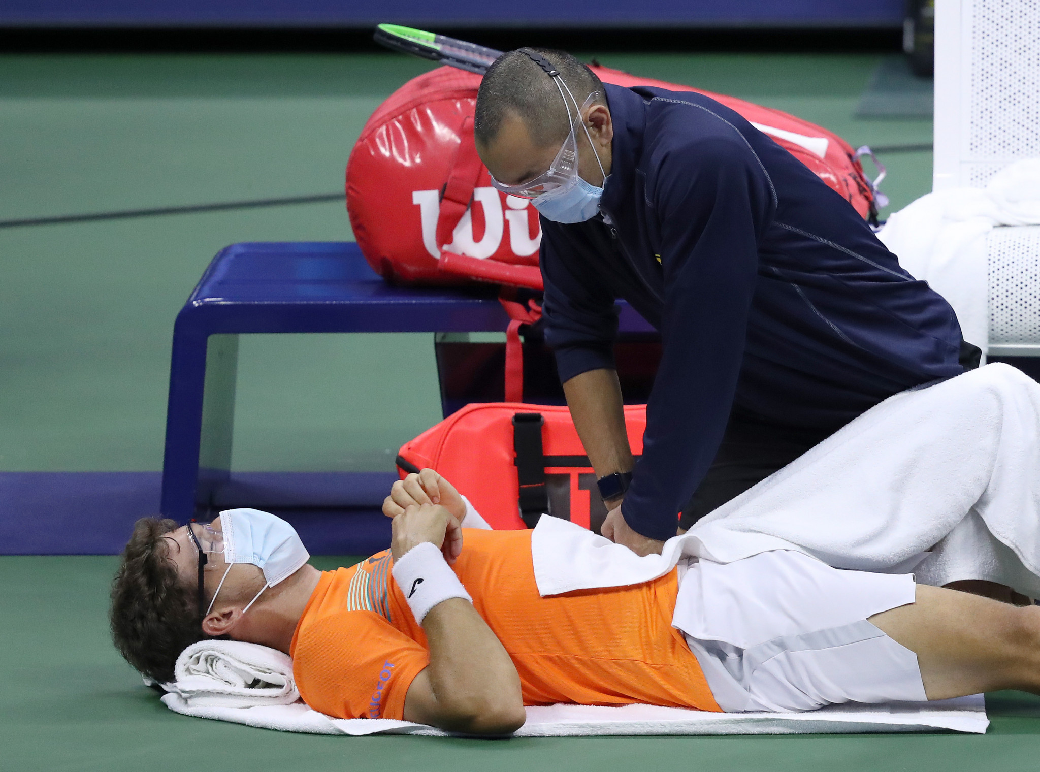 Pablo Carreno-Busta received treatment from the trainer as he lost his semi-final to Alex Zverev ©Getty Images