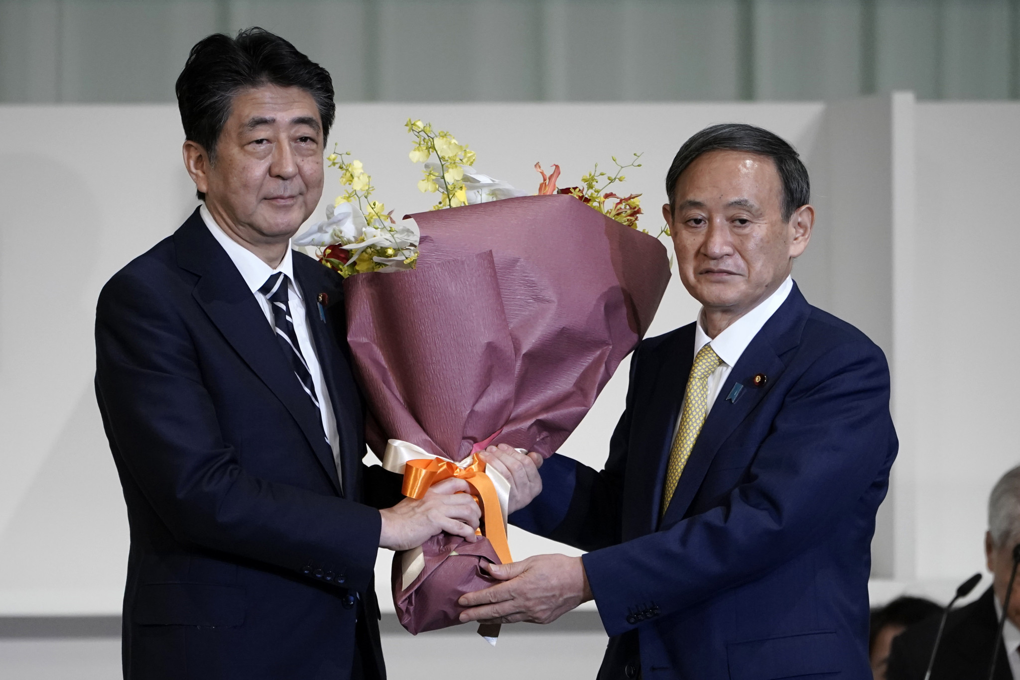 Shinzō Abe, left, has been replaced by Yoshihide Suga, right, as Japanese Prime Minister ©Getty Images