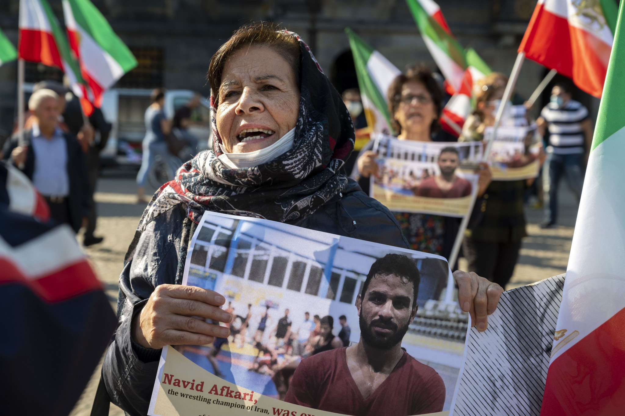 A demonstrator holds an image of Navid Afkari at a protest against the Iranian regime held in Dutch city Amsterdam ©Getty Images