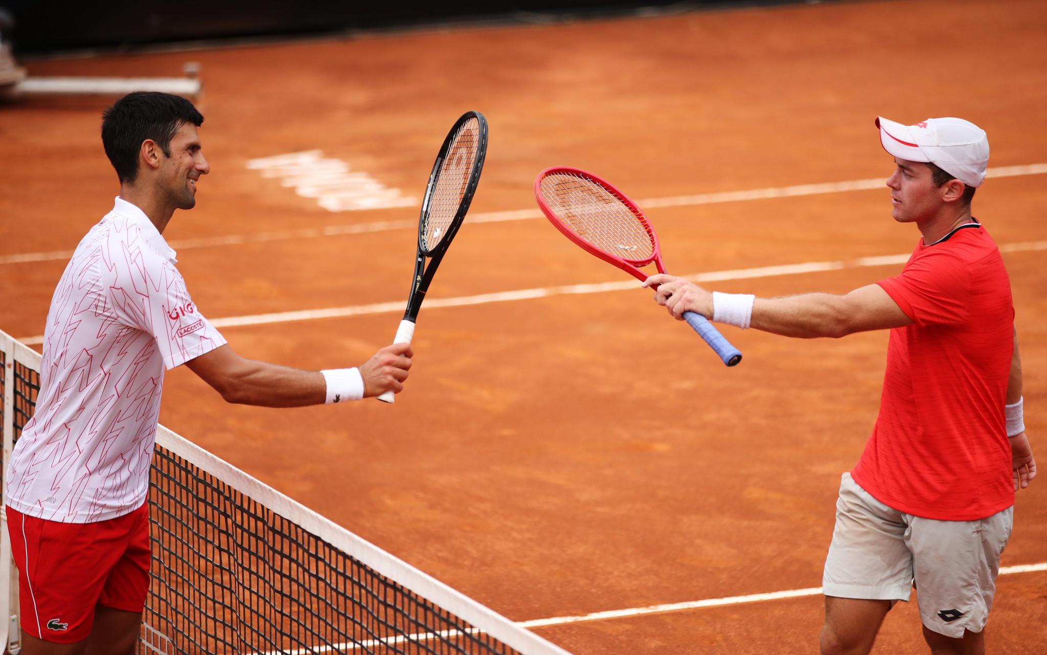 Djokovic battles through as defending champion Nadal beaten on Italian Open quarter-final day