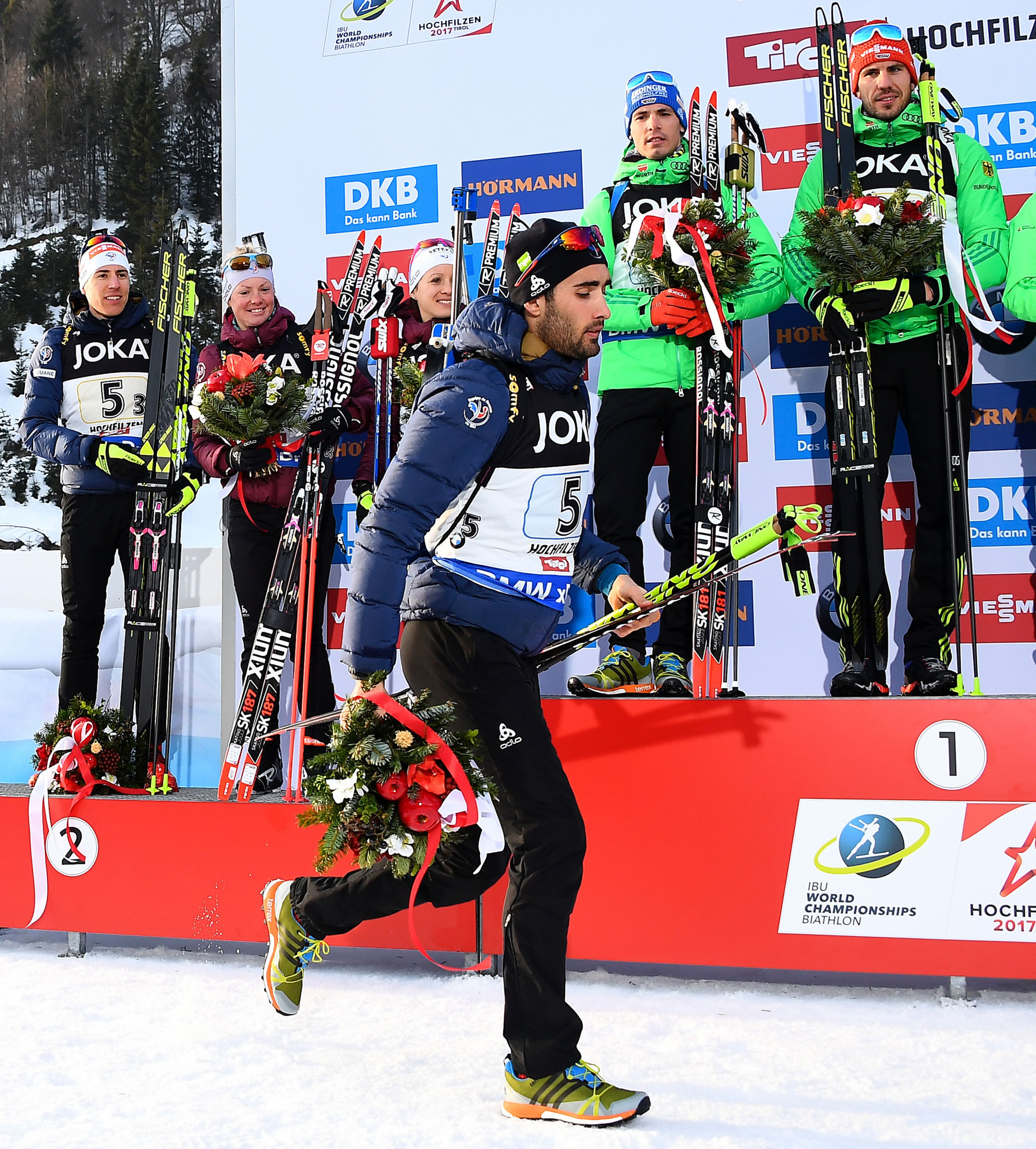 Martin Fourcade left the podium at the 2017 Biathlon World Championships as Russia received a bronze medal in the mixed relay event ©Getty Images