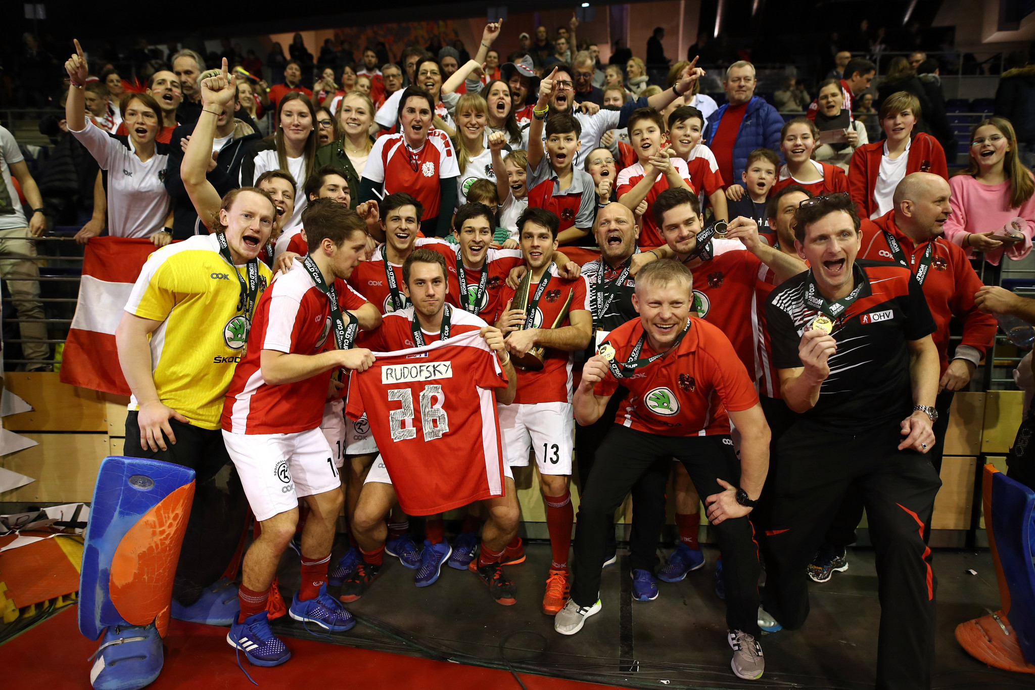 Austria celebrate after winning the 2018 Indoor Hockey World Cup in Berlin with victory over hosts Germany ©Getty Images