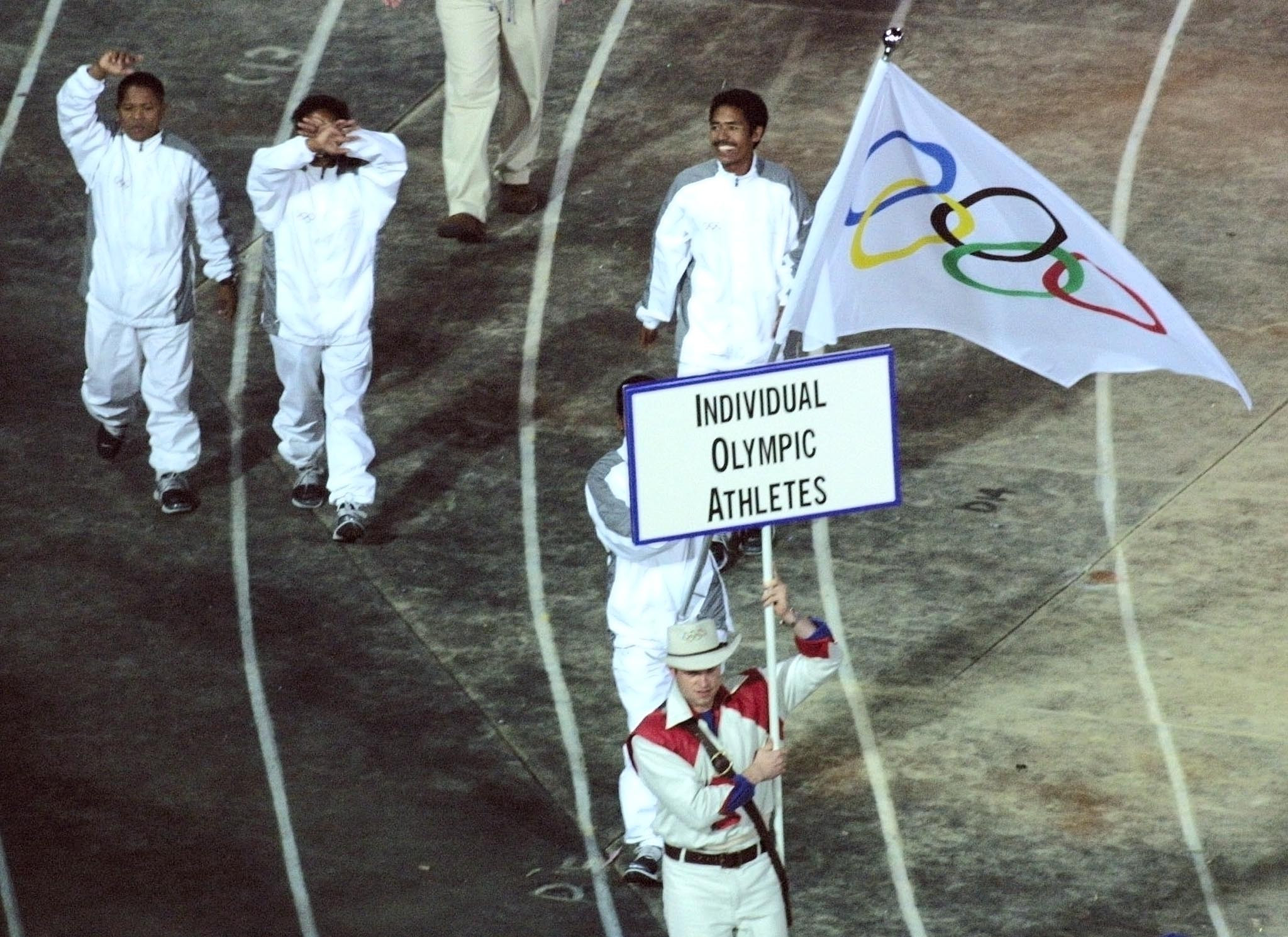 Athletes from East Timor march during the Sydney 2000 Olympic Games Opening Ceremony, where they competed as Individual Olympic Athletes ©Getty Images