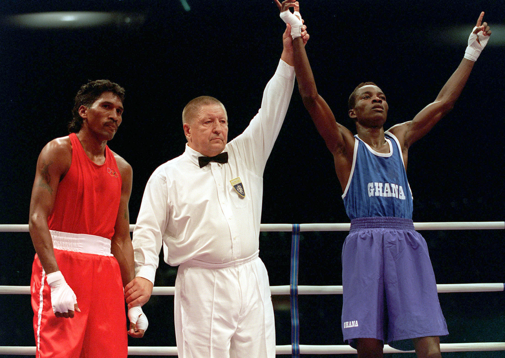 East Timor's flag bearer Victor Ramos (left) was defeated in the second round of his opening lightweight contest at Sydney 2000 ©Getty Images