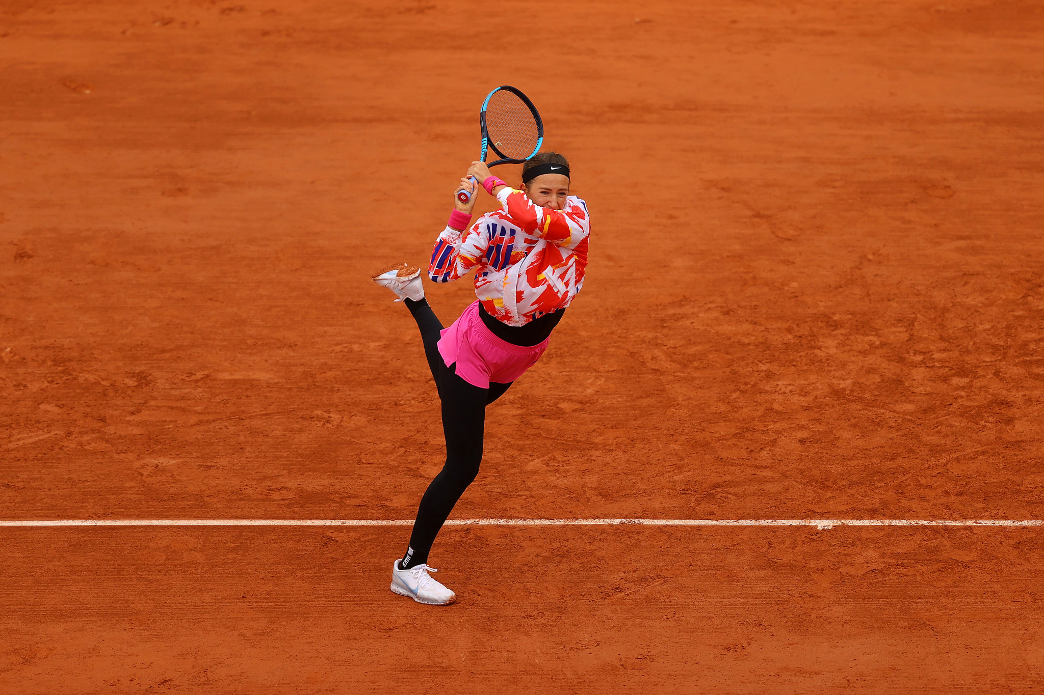 Victoria Azarenka, who was wrapped up on a chilly day in Paris, is through to round two ©Getty Images
