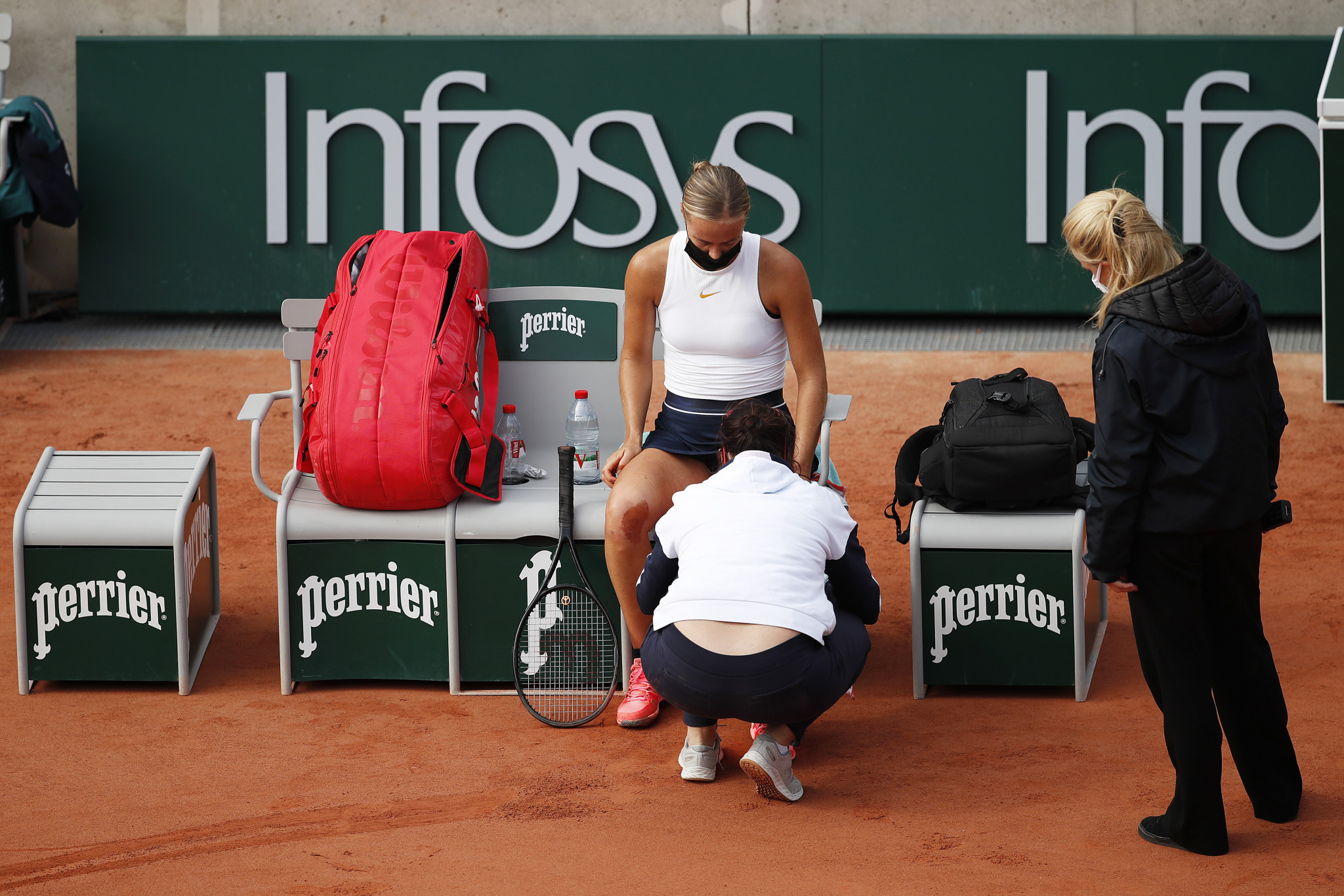 Anna Karolina Schmiedlova receives treatment from the physio, but it did not stop her upsetting Victoria Azarenka ©Getty Images