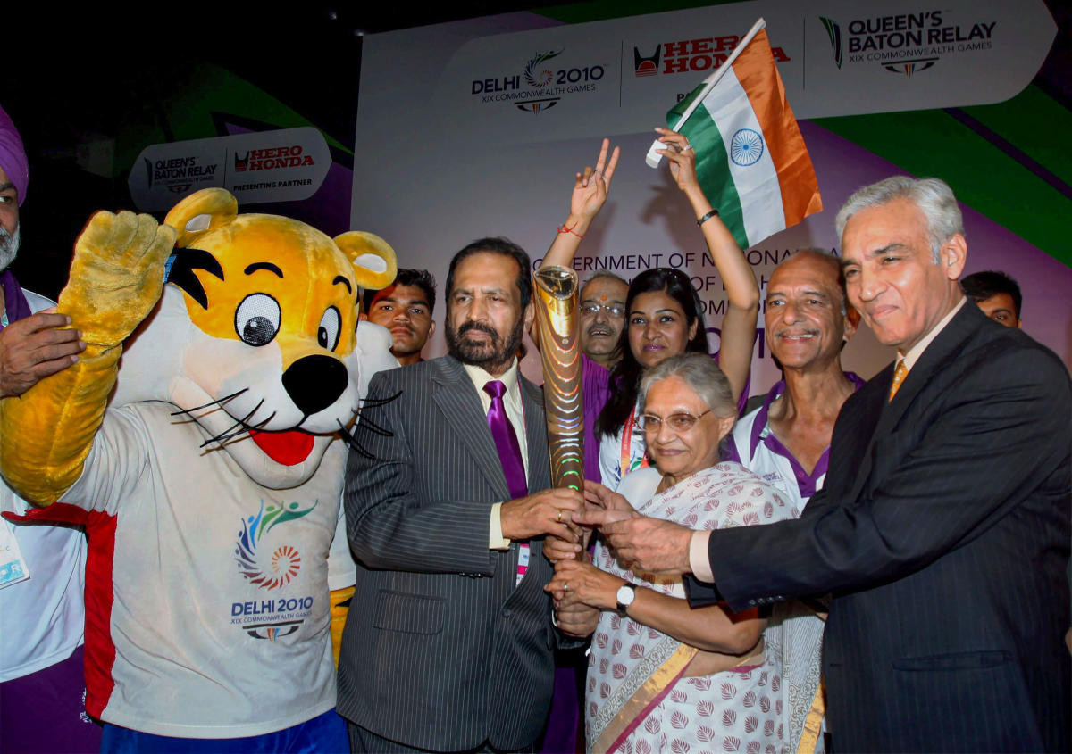 Delhi 2010 chairman Suresh Kalmadi, second left, was charged with conspiracy, forgery and misconduct after the Commonwealth Games and spent 10 months in jail ©Getty Images