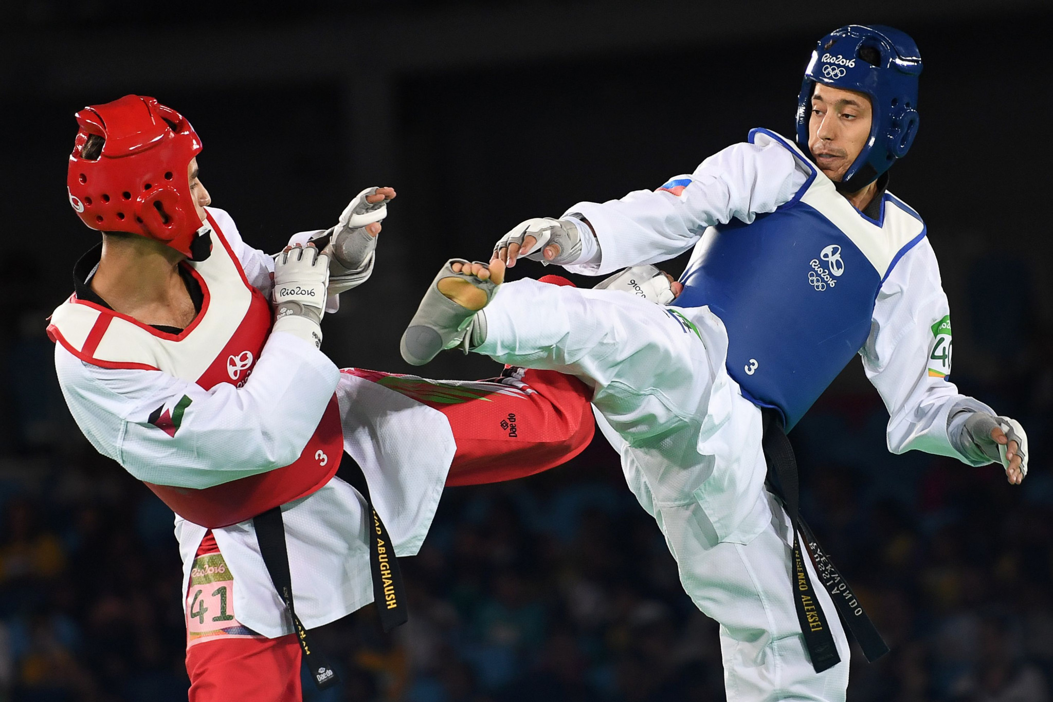 Alexey Denisenko, right, won Russia's fourth Olympic medal in taekwondo when he clinched the silver in the men's under-68kg category ©Getty Images