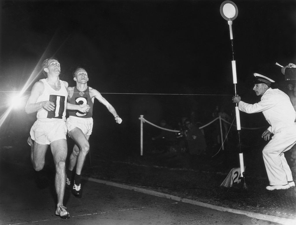 Chris Chataway, pictured beating Russia's Vladimir Kuts and the 5,000 metres world record at White City in 1954, was a self-confessed smoker during his track career ©Getty Images