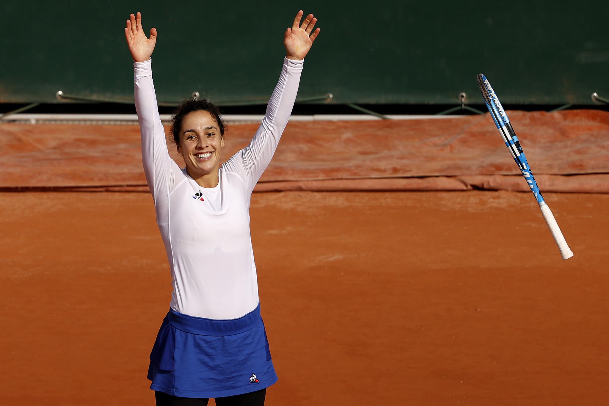 Italy's Martina Trevisan puts her arms up in celebration after knocking out fifth seed Kiki Bertens of the Netherlands ©Getty Images
