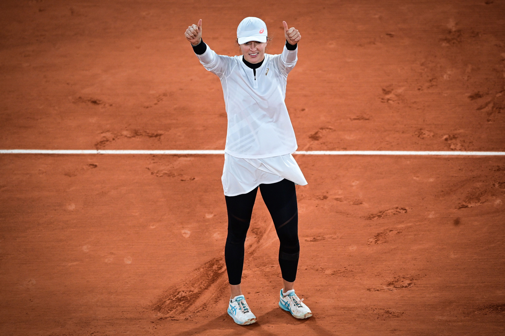Polish teenager Iga Swiatek celebrates with a thumbs-up after following up her win over top seed Simona Halep by beating Martina Trevisan ©Getty Images