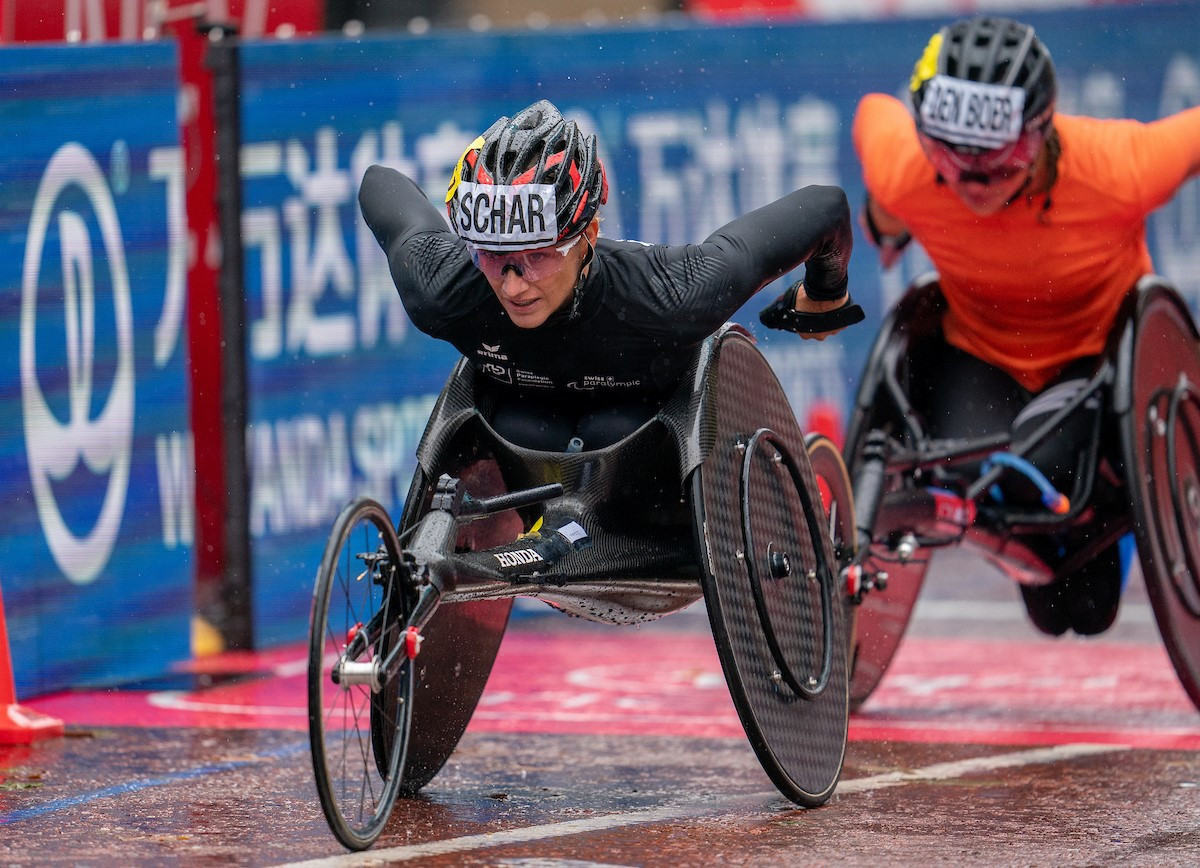 Weir Archer Academy and Wheelpower receive sprint prize money from London Marathon wheelchair race
