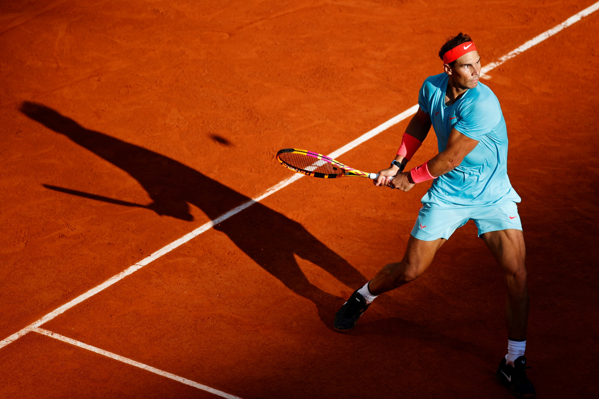 Djokovic stays unbeaten in 2020 to set up French Open final versus Nadal