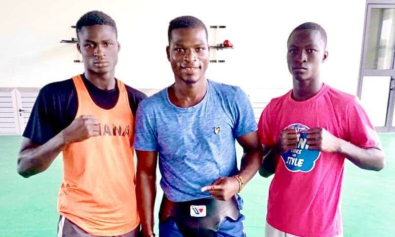 John Commey, left, had been training with Richard Commey, the former IBF lightweight champion, centre, in preparation for the 2023 African Games in Ghana ©Twitter