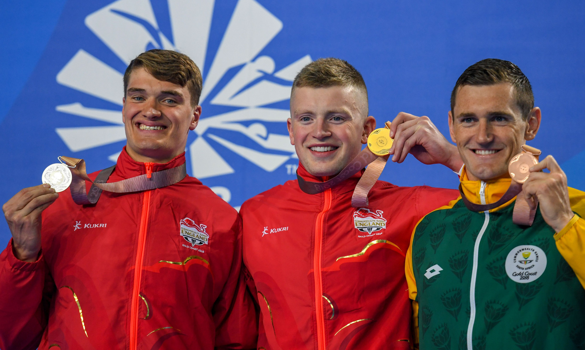 James Wilby, left, and Adam Peaty, centre, on the podium at the 2018 Commonwealth Games ©Getty Images