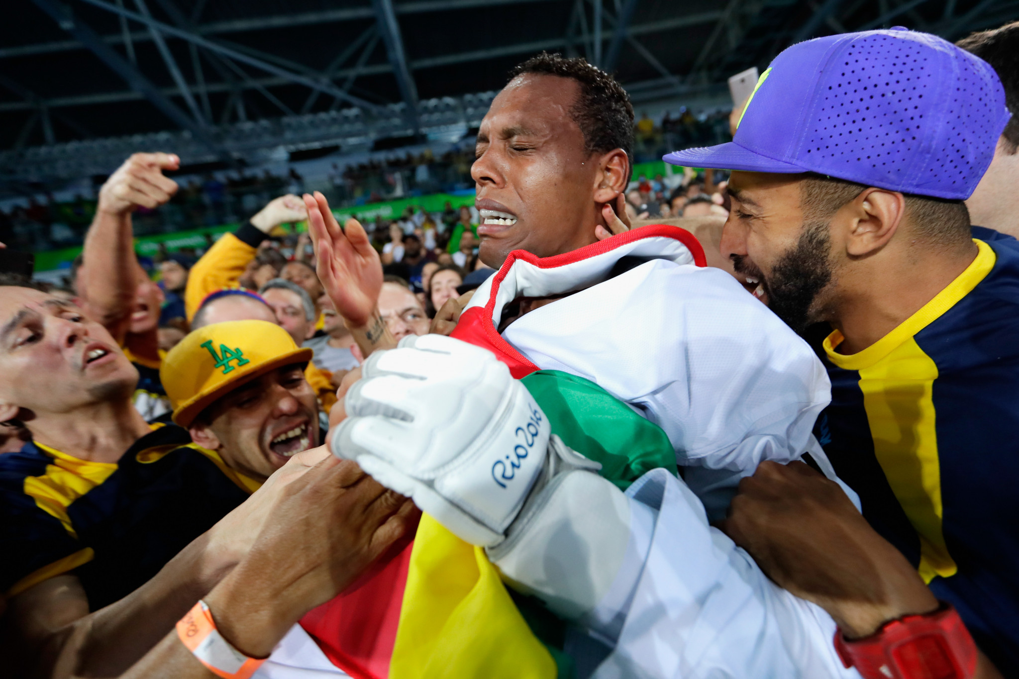 Maicon de Andrade Siqueira is mobbed as he celebrates a medal at his home Olympics ©Getty Images