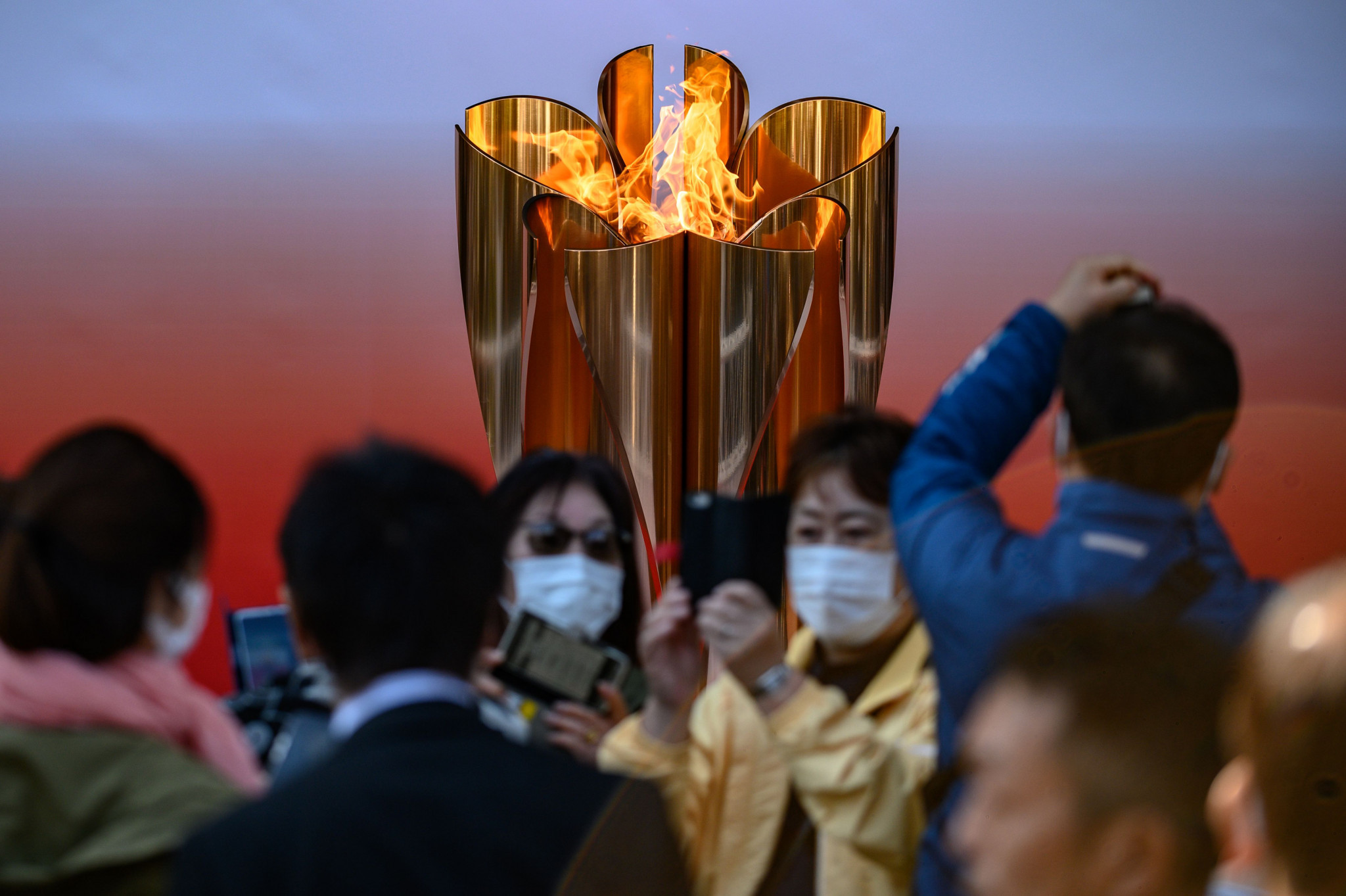 Large crowds defied fears over coronavirus to visit the Olympic flame at Sendai station in Tokyo when it was put on display in March ©Getty Images