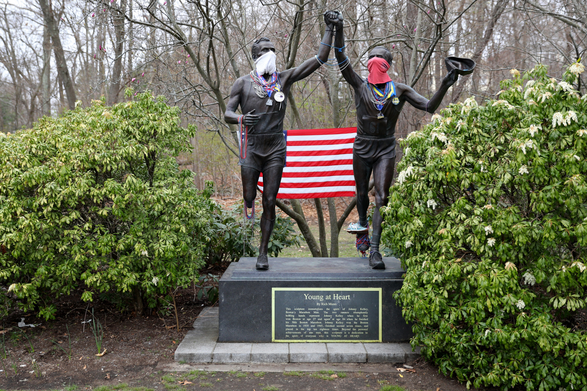 Face coverings were added to the statue of Johnny Kelley on the Heartbreak Hill section of the Boston Marathon course this year ©Getty Images