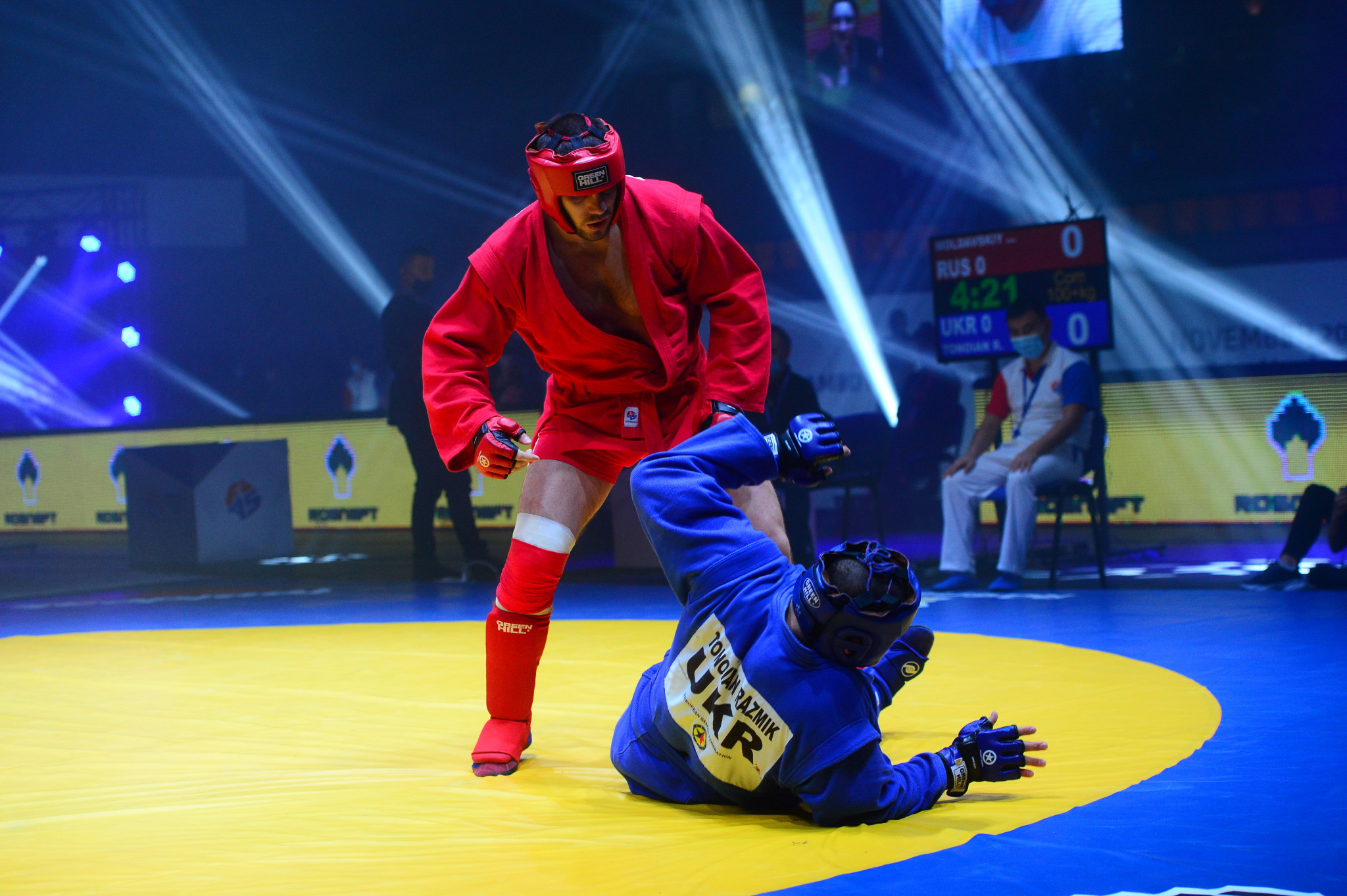 Valentin Moldavskiy, red, of Russia, thumped his opponent Razmik Tonoian of Ukraine in the combat sambo over-100kg final ©FIAS