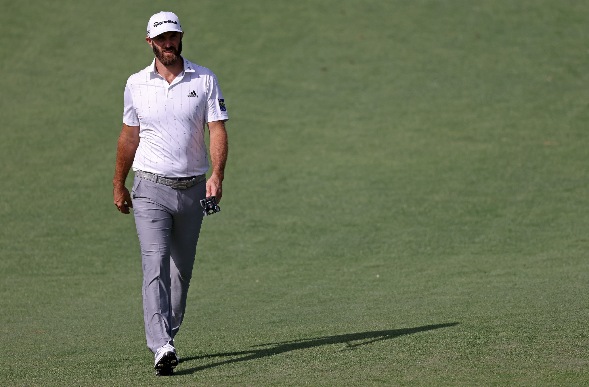 World number one Johnson takes grip on Masters with four-shot lead after round three