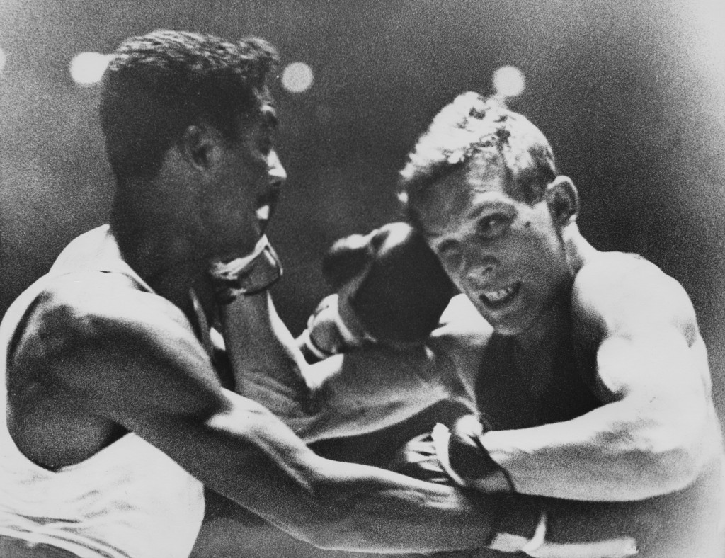 America's Wilbert McClure (left) fighting Carmelo Bossi of Italy in the Rome 1960 light middleweight final ©Hulton Archive/Getty Images
