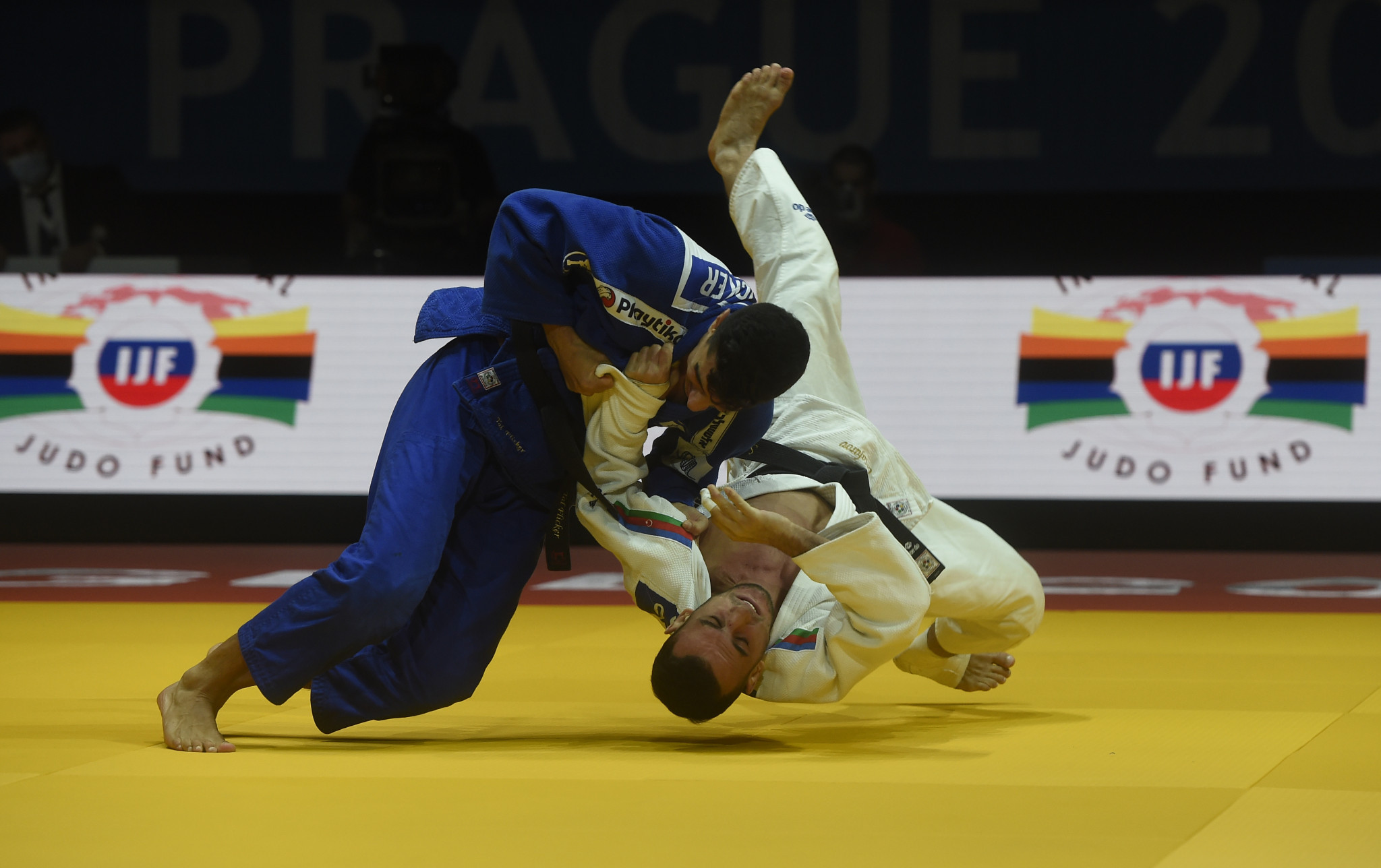 Orkhan Safarov, in white, was a surprise winner of the men's under-66kg title ©Getty Images