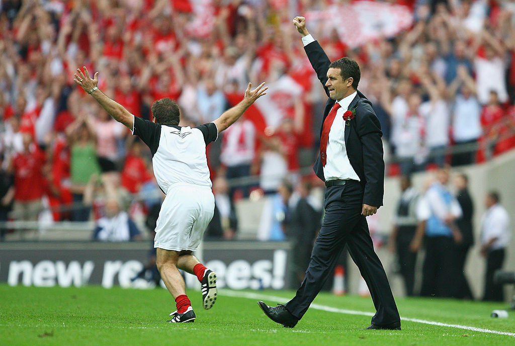 Ebbsfleet United's head coach Liam Daish salutes victory in the 2008 FA Trophy final in the year when supporters paid £35 each to take over the club and much of its running  ©Getty Images