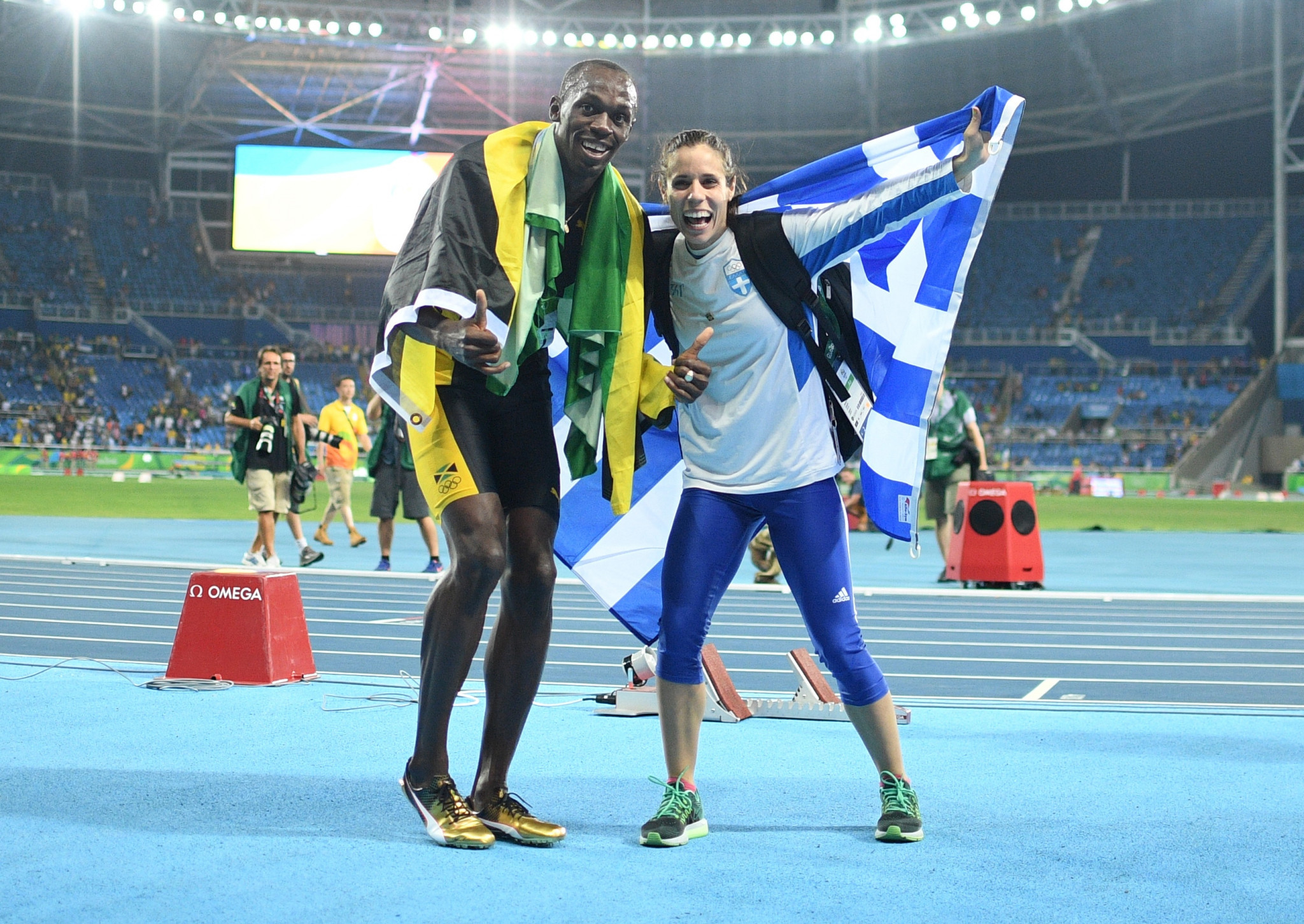 Katerina Stefanidi and fellow Olympic gold medallist Usain Bolt of Jamaica celebrate at the 2016 Rio Games ©Getty Images
