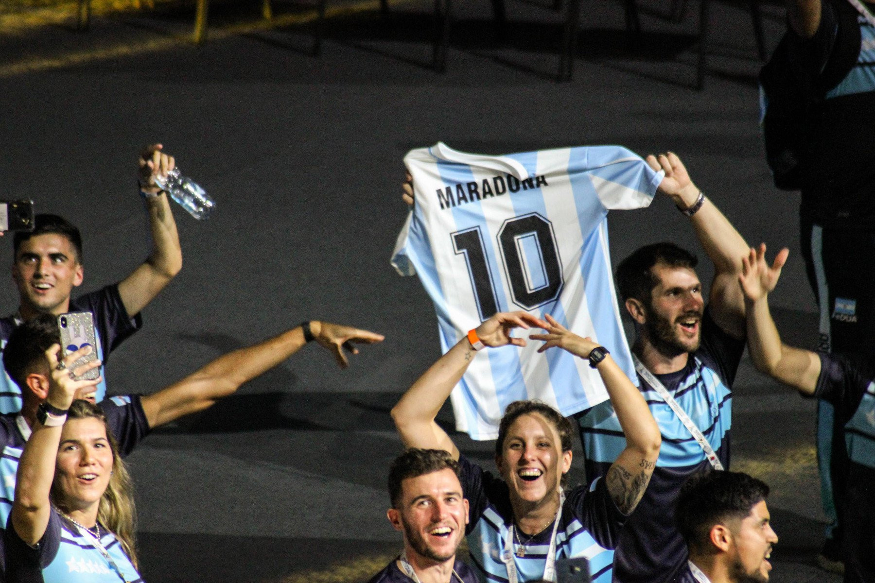 The Argentinian team held aloft a Diego Maradona shirt when they entered the San Paolo Stadium during the Naples 2019 Opening Ceremony ©Naples 2019