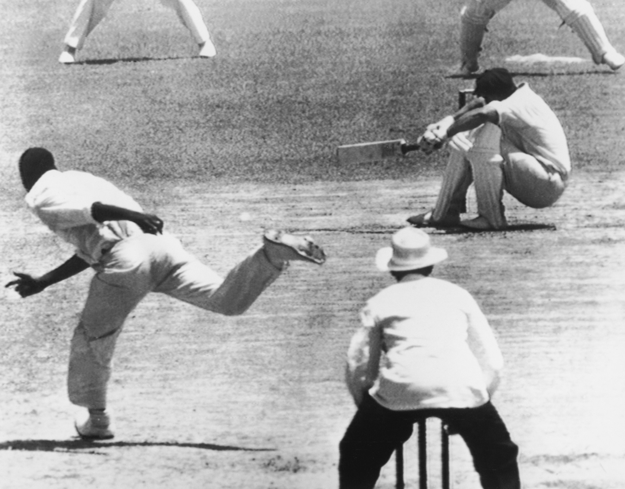 Norm O'Neill takes evasive action following a fierce Wes Hall delivery ©Getty Images