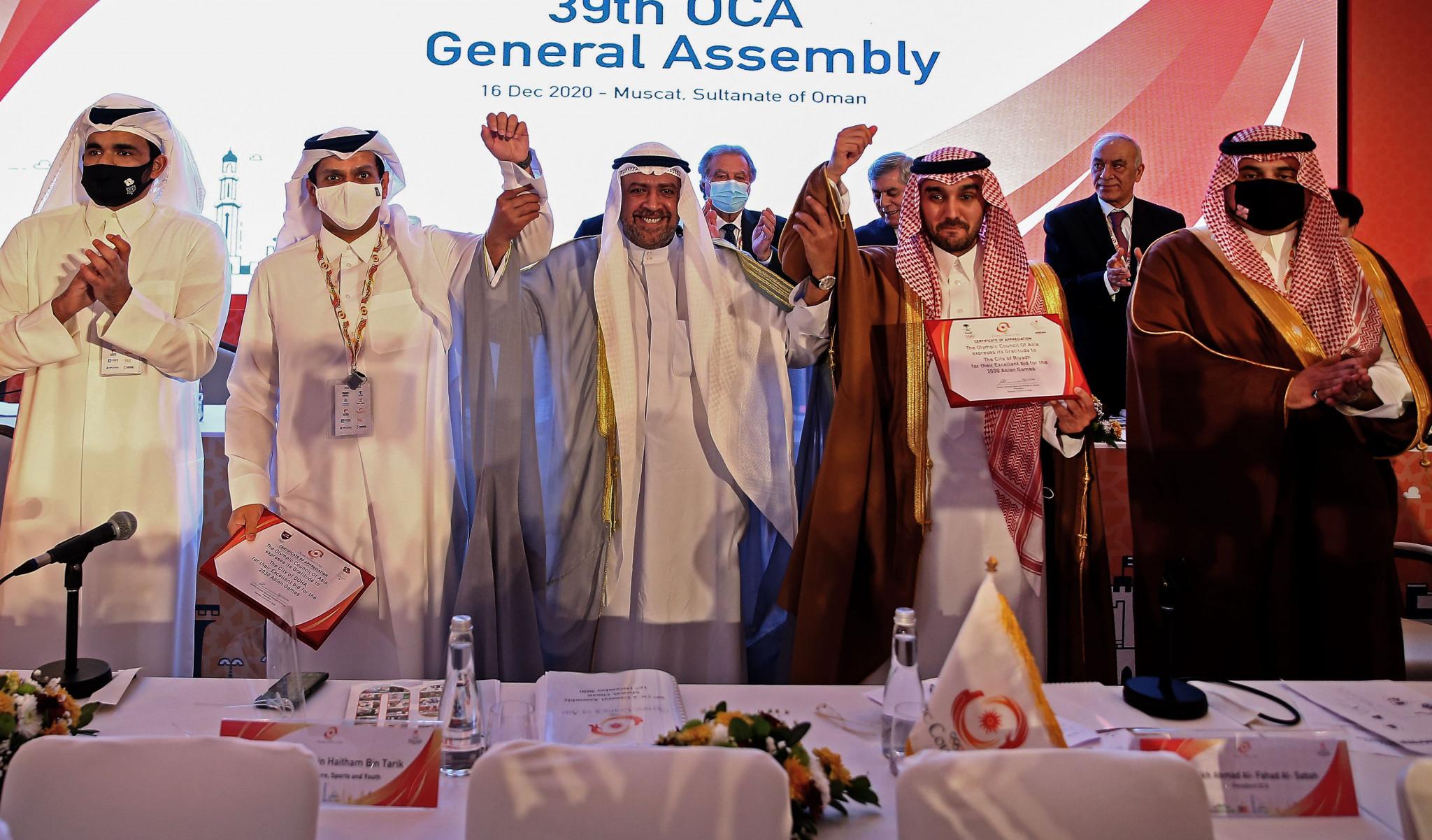 Sheikh Ahmad Al-Fahad Al-Sabah raises hands from Doha and Riyadh after the double award ©Getty Images
