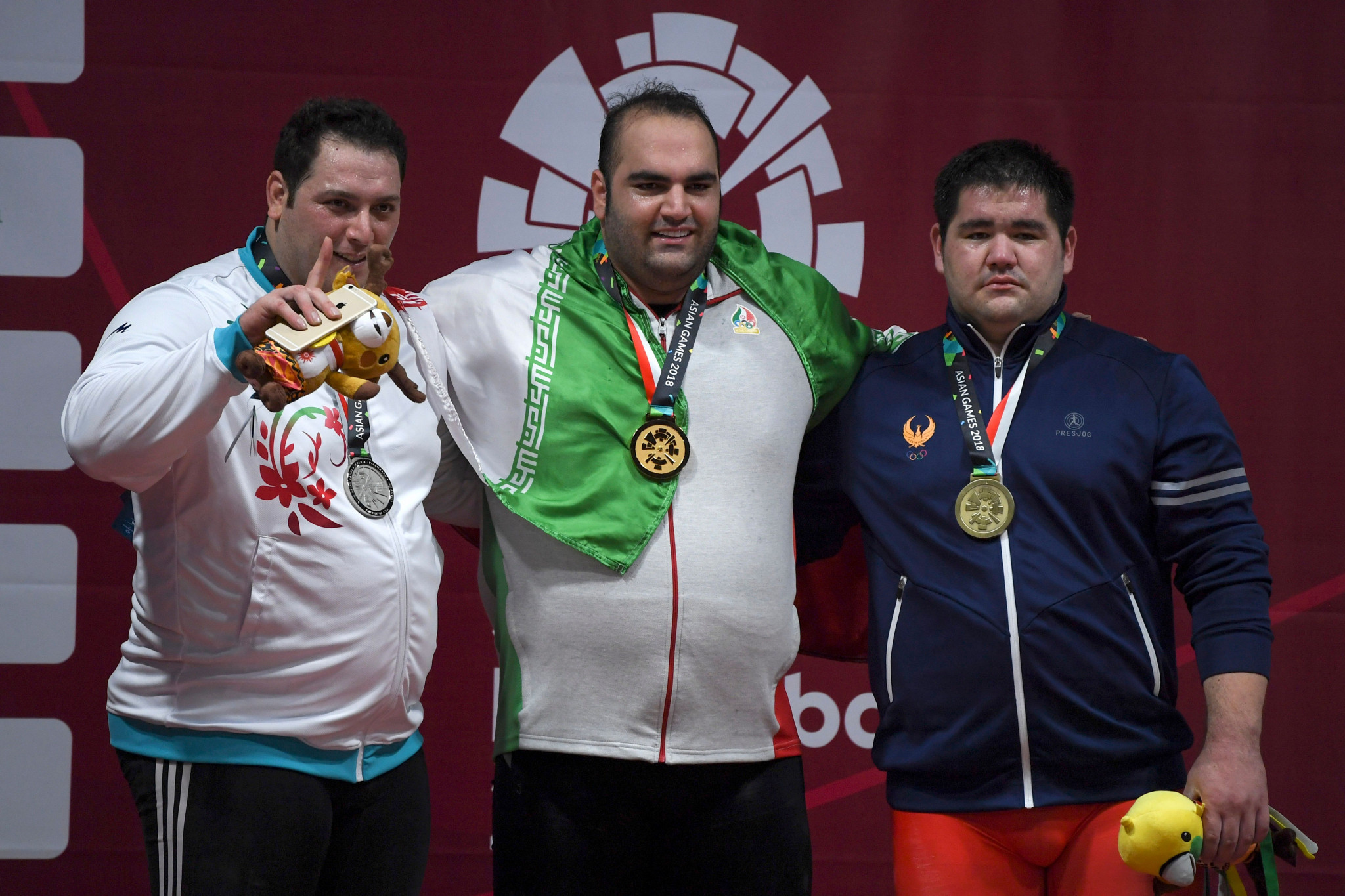 Saeid Alihosseini, left, won silver at the 2018 Asian Games before announcing his retirement a year later ©Getty Images