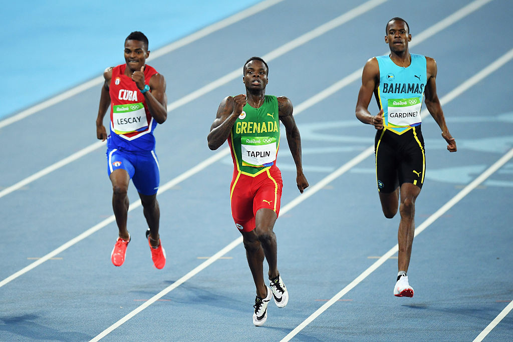 The Grenadian sprinter, centre, will not be able to return to competition until September 2026 ©Getty Images