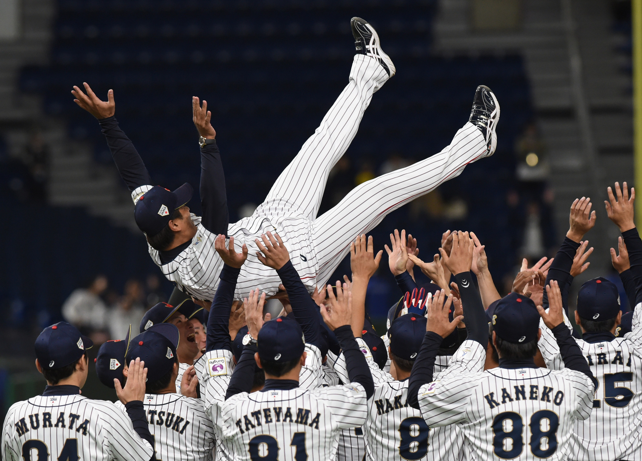 Atsunori Inaba, airborne, was manager when Japan won the 2019 WBSC Premier12 tournament ©Getty Images