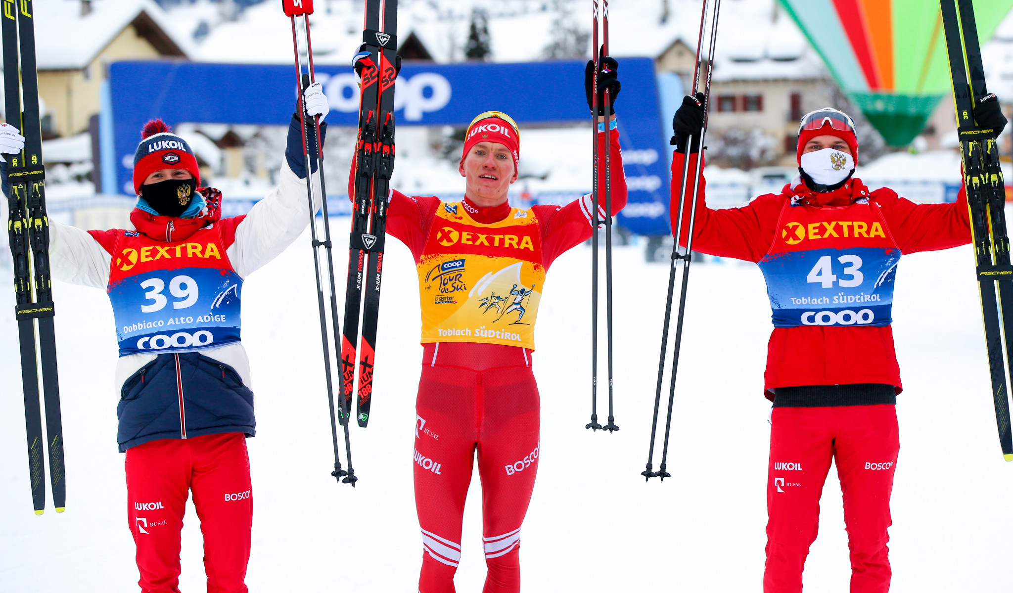 Alexander Bolshunov is flanked by compatriots Denis Spitsov and Ivan Yakimushkin after completing an all-Russian podium ©Getty Images