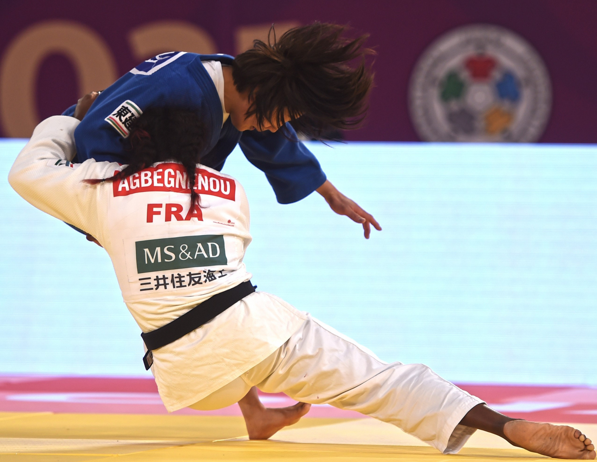 Clarisse Agbegnenou, in white, was a gold medallist at the IJF World Judo Masters in Doha ©IJF