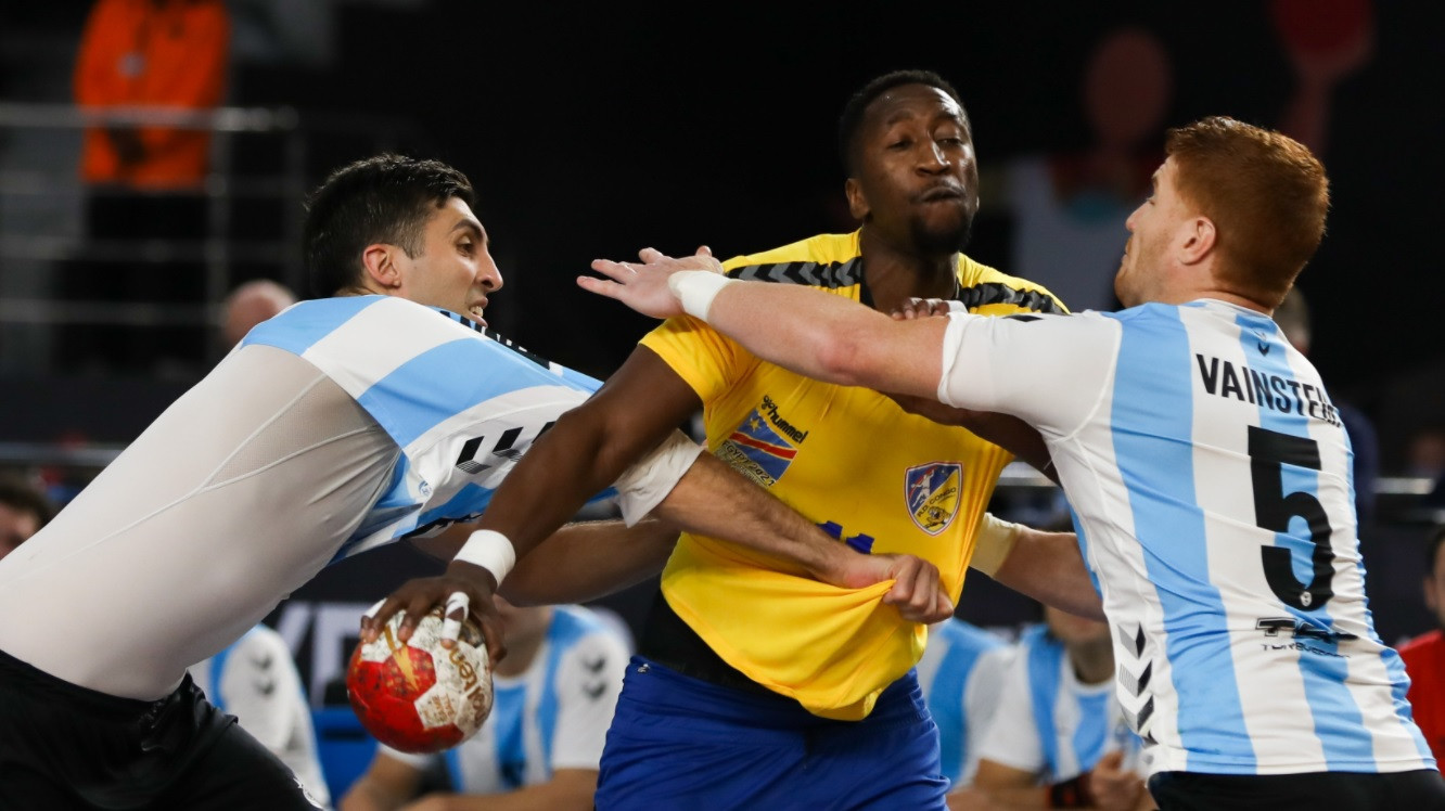 An Argentina player (blue and white) almost lost his shirt, although the team won a physical match as they beat DR Congo at the World Men's Handball Championship in Egypt ©Handball Egypt