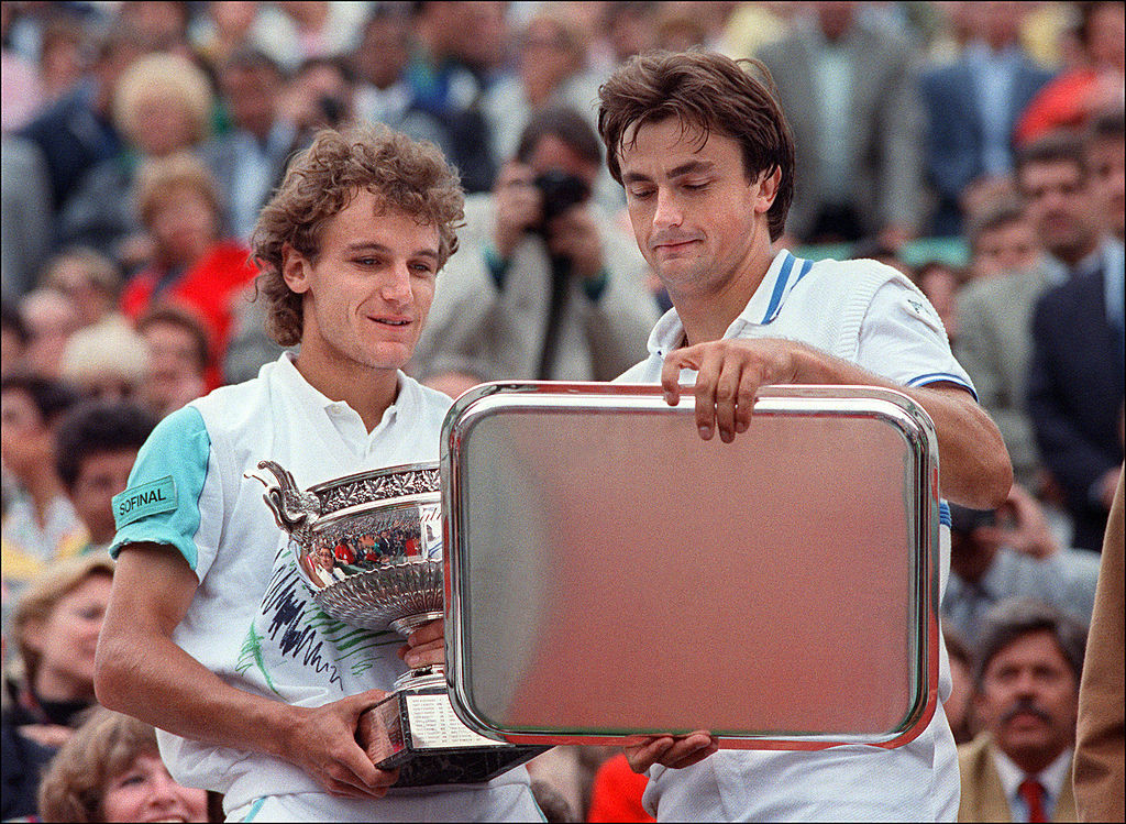 Mats Wilander, pictured left after his 1988 French Open victory over home player Henri Leconte, finished the year with three Grand Slam titles - but never won another ©Getty Images