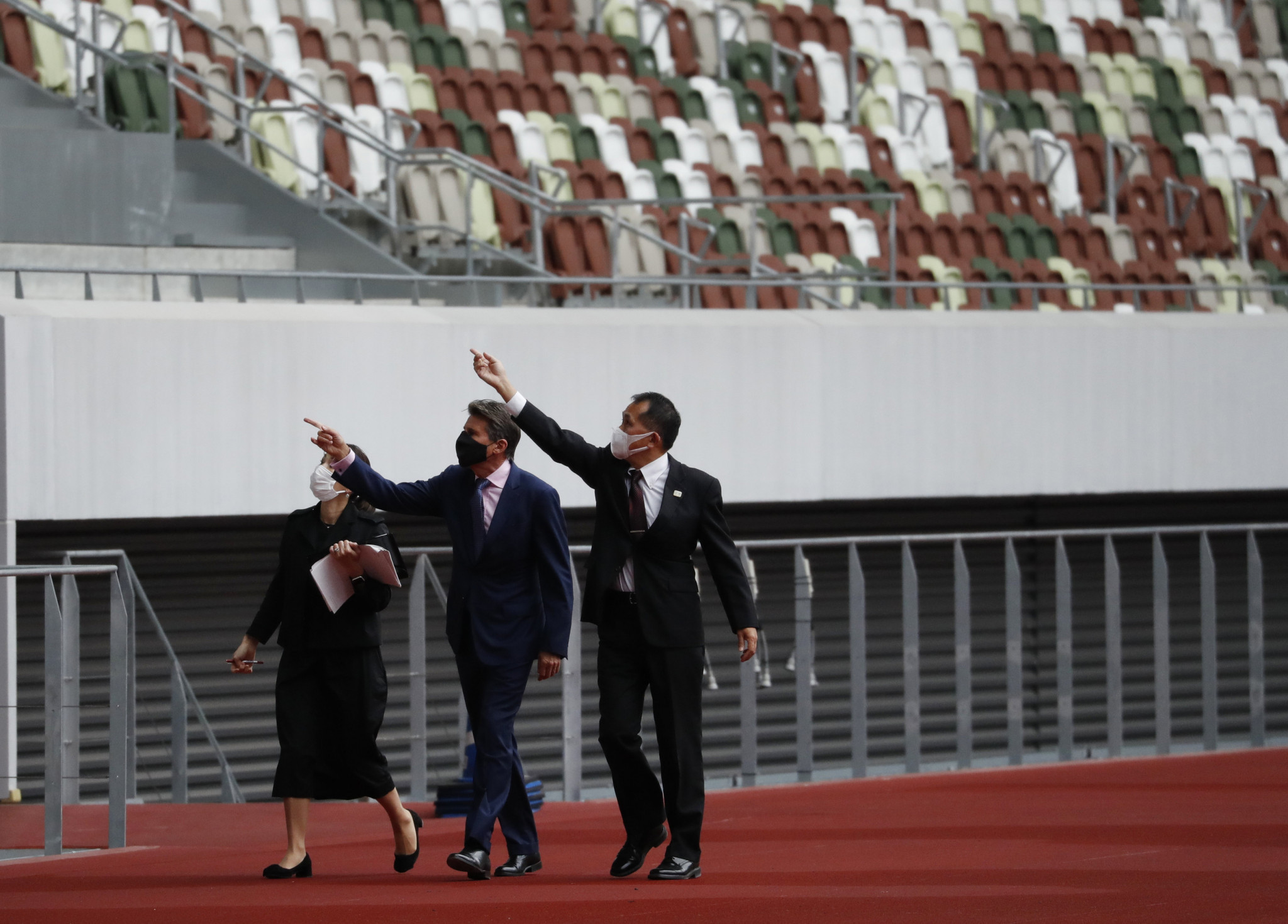 World Athletics President Sebastian Coe, centre, visited the Olympic Stadium in Tokyo last October, but foreign athletes may not be able to compete there in the Continental Tour meeting on May 9 that will also serve as the test event ©Getty Images