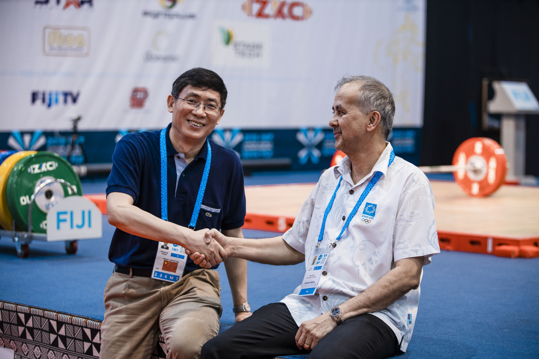President of the Chinese Weightlifting Federation Jinqiang Zhou, left, said he believed the eligibility rules should have been issued earlier to avoid some candidates gaining an